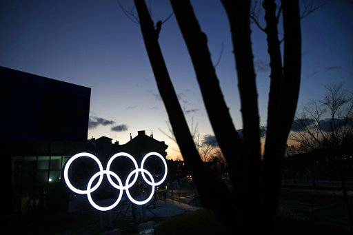 Illuminated Olympic rings shine at dusk at the Alpensia resort prior to the 2018 Winter Olympics in Pyeongchang, South Korea, Friday, Feb. 2, 2018.