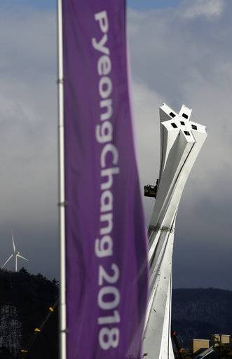 An Olympic Cauldron under construction rises beyond Olympic banners at the Alpensia resort at the 2018 Winter Olympics in Pyeongchang, South Korea, Friday, Feb. 2, 2018.
