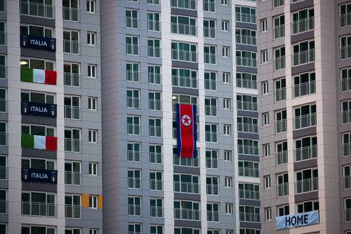 A large North Korean flag hangs from an apartment building at the Olympic Village prior to the 2018 Winter Olympics in Gangneung, South Korea, Friday, Feb. 2, 2018.