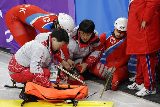 CORRECT TO NORTH KOREA, NOT SOUTH KOREA - North Korea's Choe Un Song receives medical attention after a crash during a Men's Short Track Speed Skating training session ahead of the 2018 Winter Olympics in Gangneung, South Korea, Friday, Feb. 2, 2018.