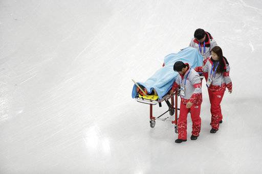 CORRECT TO NORTH KOREA, NOT SOUTH KOREA - North Korea's Choe Un Song is carried on a stretcher after a crash during a Men's Short Track Speed Skating training session ahead of the 2018 Winter Olympics in Gangneung, South Korea, Friday, Feb. 2, 2018.