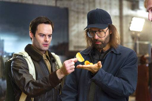 This photo provided by Pringles shows a scene from the company's Super Bowl spot, featuring actors Bill Hader, left, and Sky Elobar. For the 2018 Super Bowl, marketers are paying more than $5 million per 30-second spot to capture the attention of more than 110 million viewers. (Rob Kalmbach/Courtesy of Pringles via AP)