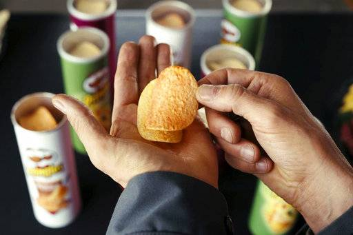 This photo provided by Pringles shows a scene with Sky Elobar from the company's Super Bowl spot. For the 2018 Super Bowl, marketers are paying more than $5 million per 30-second spot to capture the attention of more than 110 million viewers. (Rob Kalmbach/Courtesy of Pringles via AP)