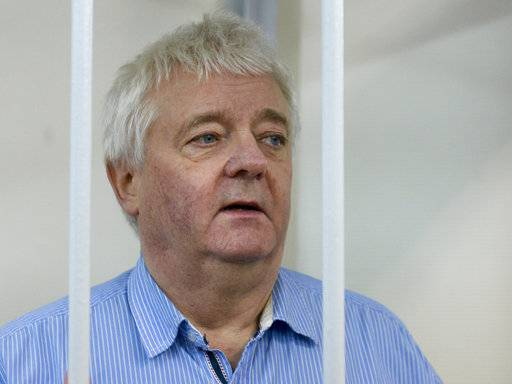 Norwegian national Frude Berg, who is accused of spying on Russia, stands in a cage in Lefortovo district court in Moscow, Russia, Friday, Feb. 2, 2018. A Russian court has ruled to keep Frude Berg in jail pending a probe on charges of espionage he has rejected. Frude Berg has been in custody since his December's arrest in Moscow.
