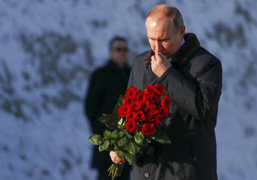 Russian President Vladimir Putin attends a  ceremony at the monument to Motherland during ceremonies marking the 75th anniversary of the Battle of Stalingrad in the southern Russian city of Volgograd, once known as Stalingrad, Russia, Friday, Feb. 2, 2018. The five months of fighting in Stalingrad between August 1942 and February 1943 is regarded as the bloodiest war battle in history. The death toll for soldiers and civilians was about 2 million. Most of the city was reduced to rubble before Nazi forces surrendered on Feb. 2, 1943. (Maxim Shemetov/Pool Photo via AP)