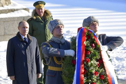 Russian President Vladimir Putin, left, attends a laying ceremony at the monument to Motherland during ceremonies marking the 75th anniversary of the Battle of Stalingrad in the southern Russian city of Volgograd, once known as Stalingrad, Russia, Friday, Feb. 2, 2018. The five months of fighting in Stalingrad between August 1942 and February 1943 is regarded as the bloodiest war battle in history. The death toll for soldiers and civilians was about 2 million. Most of the city was reduced to rubble before Nazi forces surrendered on Feb. 2, 1943. (Alexei Druzhinin, Sputnik, Kremlin Pool Photo via AP)