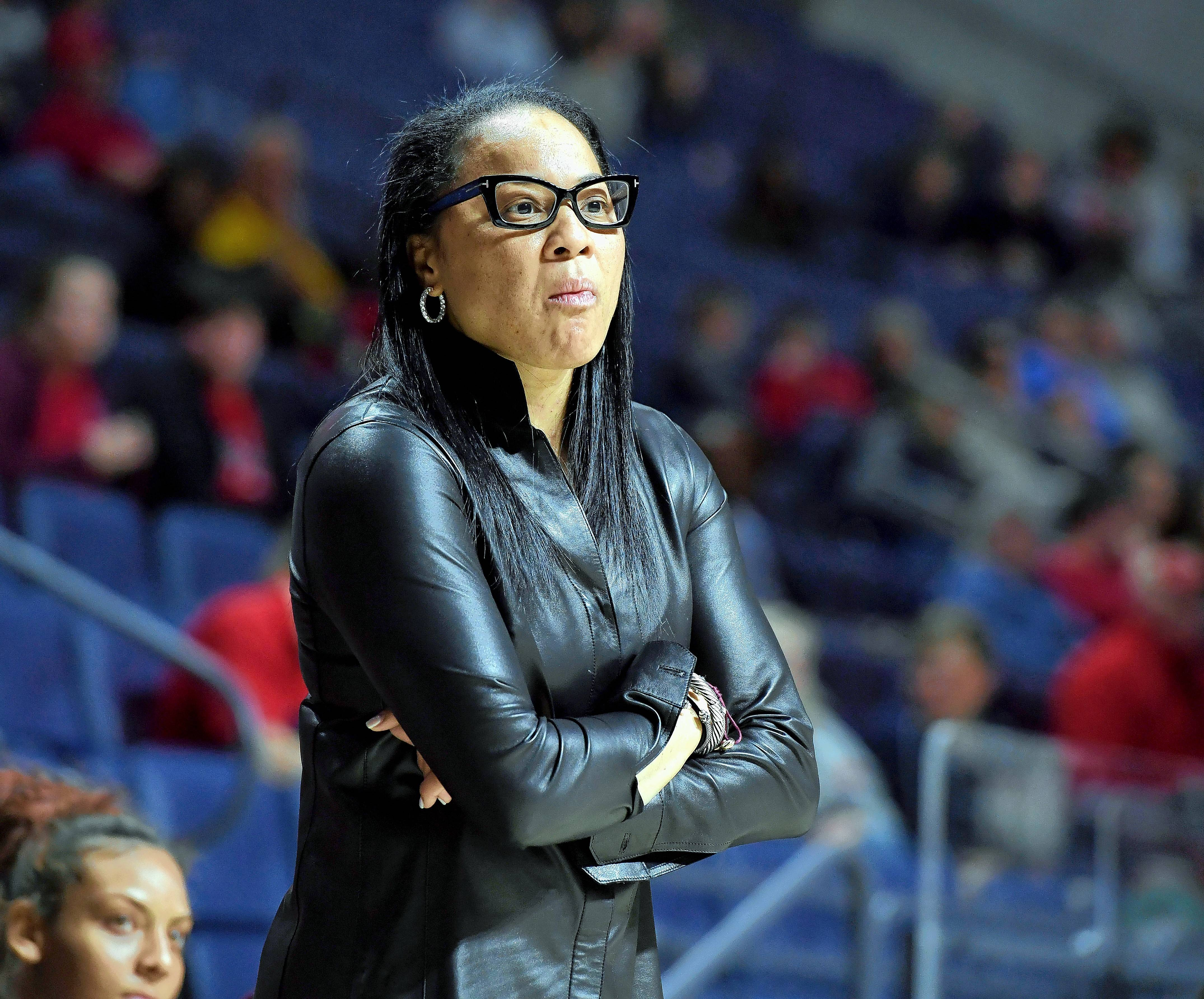 The Missouri women's basketball team says that fans of South Carolina, the defending national champion, spit on Missouri players and used racial slurs against them at Sunday's game at South Carolina. Hard to believe, considering all 10 South Carolina players and their coach, Dawn Staley above, are black. But if true, this is exactly what women's sports doesn't need.
