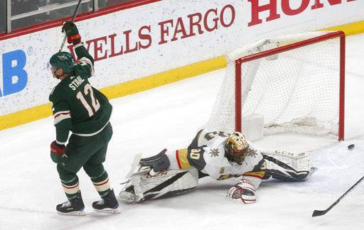 Minnesota Wild's Eric Staal, left, scores on Vegas Golden Knights goalie Malcolm Subban during the first period of an NHL hockey game Friday, Feb. 2, 2018, in St. Paul, Minn.