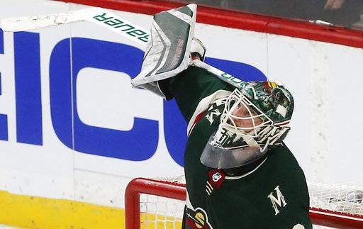 Minnesota Wild goalie Devan Dubnyk celebrates his team's win over the Vegas Golden Knights in an NHL hockey game Friday, Feb. 2, 2018, in St. Paul, Minn.