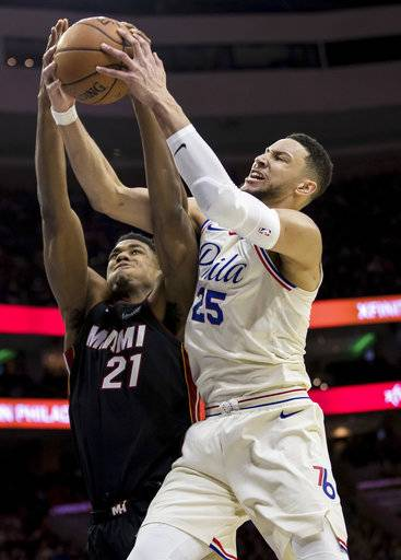 Miami Heat's Hassan Whiteside, left, and Philadelphia 76ers' Ben Simmons go for a rebound during the first half of an NBA basketball game Friday, Feb. 2, 2018, in Philadelphia.