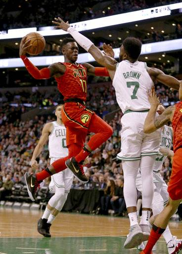 Atlanta Hawks guard Dennis Schroeder (17) drives to the basket against Boston Celtics guard Jaylen Brown (7) during the first half of an NBA basketball game Friday, Feb. 2, 2018, in Boston.