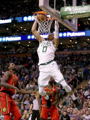Boston Celtics forward Jayson Tatum (0) dunks against the Atlanta Hawks during the second half of an NBA basketball game Friday, Feb. 2, 2018, in Boston.