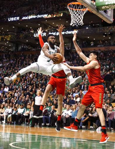 Boston Celtics guard Jaylen Brown (7) drives to the basket against Atlanta Hawks forward Ersan Ilyasova, right, during the second half of an NBA basketball game Friday, Feb. 2, 2018, in Boston.