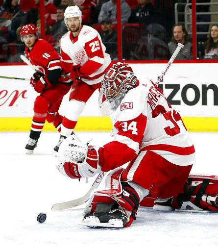 Detroit Red Wings goaltender Petr Mrazek (34) blocks a shot by the Carolina Hurricanes during the second period of an NHL hockey game Friday, Feb. 2, 2018, in Raleigh, N.C.