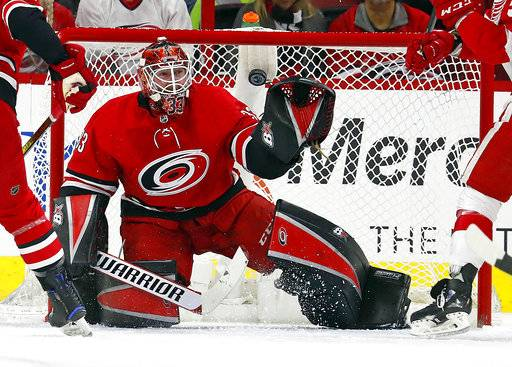 Carolina Hurricanes goaltender Scott Darling eyes the puck during the second period of the team's NHL hockey game against the Detroit Red Wings, Friday, Feb. 2, 2018, in Raleigh, N.C.