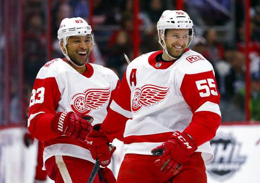 Detroit Red Wings' Trevor Daley (83) is congratulated on his goal against the Carolina Hurricanes by teammate Niklas Kronwall (55) during the second period of an NHL hockey game Friday, Feb. 2, 2018, in Raleigh, N.C.
