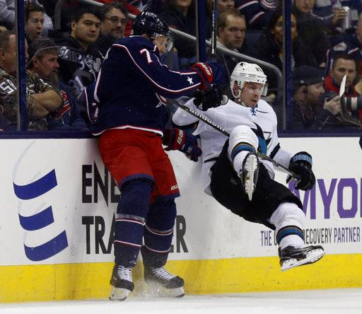 Columbus Blue Jackets defenseman Jack Johnson, left, checks San Jose Sharks forward Joonas Donskoi, of Finland, during the first period of an NHL hockey game in Columbus, Ohio, Friday, Feb. 2, 2018.