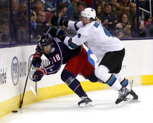 San Jose Sharks defenseman Brenden Dillon, right, checks Columbus Blue Jackets forward Pierre-Luc Dubois during the second period of an NHL hockey game in Columbus, Ohio, Friday, Feb. 2, 2018.