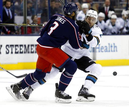 San Jose Sharks defenseman Brenden Dillon, right, collides with Columbus Blue Jackets defenseman Seth Jones during the first period of an NHL hockey game in Columbus, Ohio, Friday, Feb. 2, 2018.