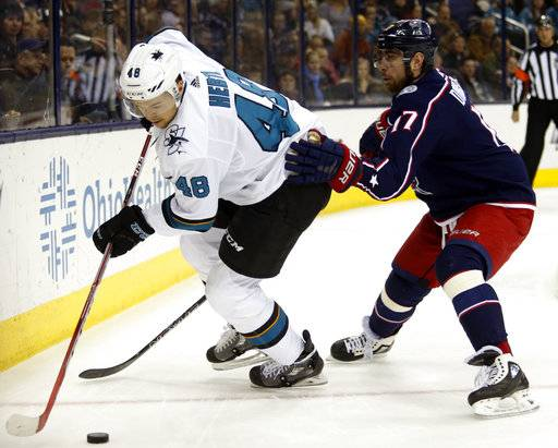 San Jose Sharks forward Tomas Hertl, left, of the Czech Republic, chases the puck next to Columbus Blue Jackets forward Brandon Dubinsky during the first period of an NHL hockey game in Columbus, Ohio, Friday, Feb. 2, 2018.