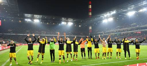Dortmund's team celebrates after winning the German Bundesliga soccer match between 1. FC Cologne and Borussia Dortmund in Cologne, Germany, Friday, Feb. 2, 2018. Cologne was defeated by Dortmund with 2-3.