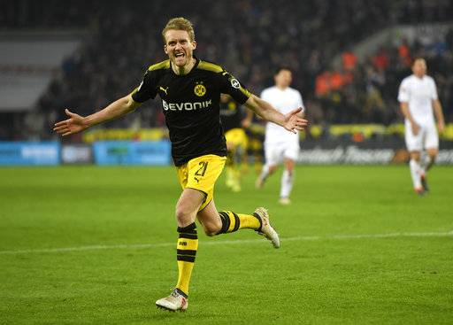 Dortmund's Andre Schuerrle celebrates after scoring his side's third goal during the German Bundesliga soccer match between 1. FC Cologne and Borussia Dortmund in Cologne, Germany, Friday, Feb. 2, 2018.