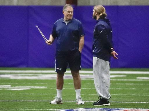 New England Patriots head coach Bill Belichick, left, talks with his son, safeties coach Steve Belichick, during a practice Friday, Feb. 2, 2018, in Minneapolis. The Patriots are scheduled to face the Philadelphia Eagles in the NFL Super Bowl 52 football game Sunday, Feb. 4.