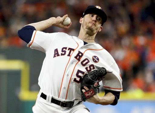 FILE - In this Saturday, Oct. 28, 2017 file photo, Houston Astros relief pitcher Ken Giles throws against the Los Angeles Dodgers during the ninth inning of Game 4 of baseball's World Series in Houston. Houston closer Ken Giles and Miami first baseman Justin Bour went to hearings Thursday, Feb. 1, 2018.  Giles asked Phillip LaPorte, Andrew Strongin and Skratek for a raise from $555,100 to $4.6 million, $400,000 more than Houston's offer.