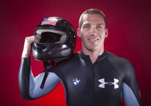 FILE - In this Sept. 30, 2013, file photo, United States Olympic Bobsledder Chris Fogt poses for a portrait at the 2013 Team USA Media Summit in Park City, Utah. For whatever reason, sliding sports have always gotten tons of attention from the military, and the team that is wearing red, white and blue in Korea has plenty of people who wear the flag at work as well. Fogt, an Army captain, has done multiple tours overseas.