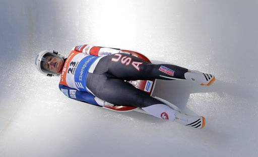 FILE- In this Dec. 17, 2016, file photo, Emily Sweeney, of the United States, slides down the course during a women's World Cup Luge event in Park City, Utah. For whatever reason, sliding sports have always gotten tons of attention from the military, and the team that is wearing red, white and blue in Korea has plenty of people who wear the flag at work as well. Sweeney is in the Army.