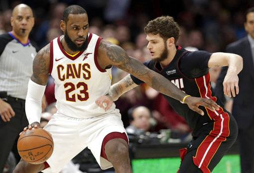 Cleveland Cavaliers' LeBron James drives past Miami Heat's Tyler Johnson in the second half of an NBA basketball game, Wednesday, Jan. 31, 2018, in Cleveland. The Cavaliers won 91-89.