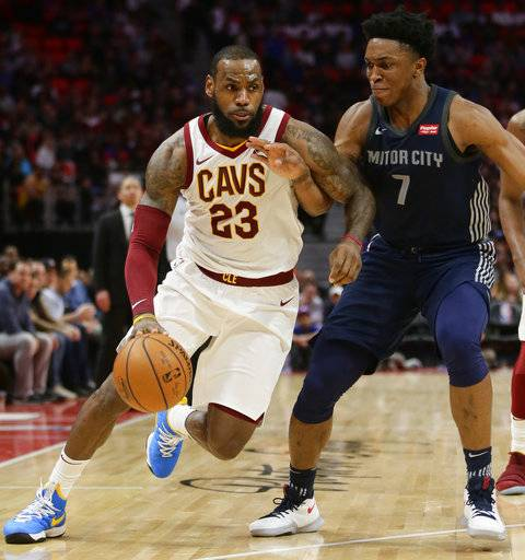 Cleveland Cavaliers forward LeBron James (23) drives against Detroit Pistons forward Stanley Johnson (7) during the second half of an NBA basketball game Tuesday, Jan. 30, 2018, in Detroit. The Pistons defeated the Cavaliers 125-114.