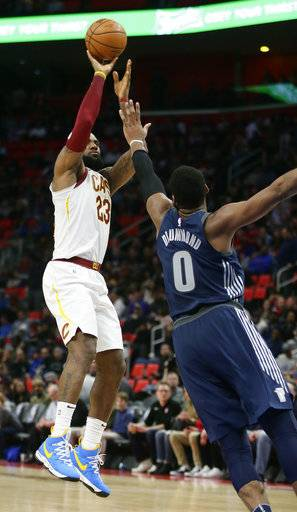 Cleveland Cavaliers forward LeBron James (23) takes a shot against Detroit Pistons center Andre Drummond (0) during the second half of an NBA basketball game Tuesday, Jan. 30, 2018, in Detroit. The Pistons defeated the Cavaliers 125-114.