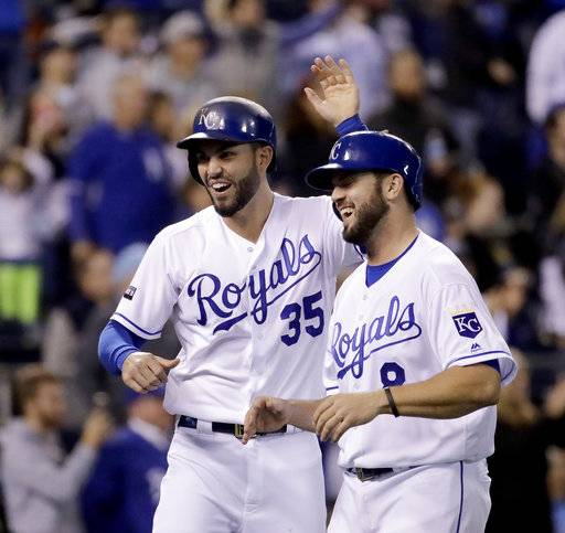 FILE - In this Sept. 27, 2017, file photo, Kansas City Royals' Eric Hosmer (35) and Mike Moustakas (8) celebrate after they scored on a double by Alcides Escobar during the eighth inning of a baseball game against the Detroit Tigers in Kansas City, Mo. Agent Brodie Van Wagenen, co-head of CAA Baseball, said Friday, Feb. 2, 2018, that baseball players should consider boycotting spring training because of the slow free-agent market. J.D. Martinez, Eric Hosmer, Mike Moustakas, Jake Arrieta, Alex Cobb, Greg Holland and Lance Lynn remain among the dozens of unsigned players with the Feb. 14 start of spring training less than two weeks away.