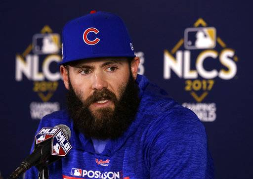 FILE - In this Oct. 17, 2017, file photo, Chicago Cubs pitcher Jake Arrieta talks during a news conference before Game 3 of baseball's National League Championship Series against the Los Angeles Dodgers in Chicago. Agent Brodie Van Wagenen, co-head of CAA Baseball, said Friday, Feb. 2, 2018, that baseball players should consider boycotting spring training because of the slow free-agent market. J.D. Martinez, Eric Hosmer, Mike Moustakas, Jake Arrieta, Alex Cobb, Greg Holland and Lance Lynn remain among the dozens of unsigned players with the Feb. 14 start of spring training less than two weeks away.