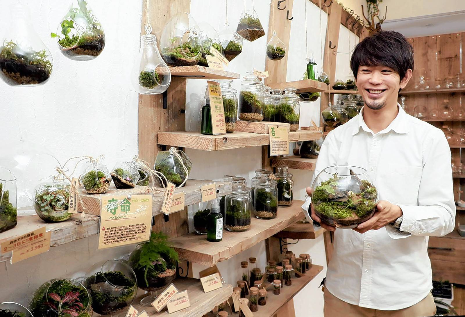 Yutaka Imada, owner of Moss-Connect in Osaka, Japan, sells moss terrariums in his store.