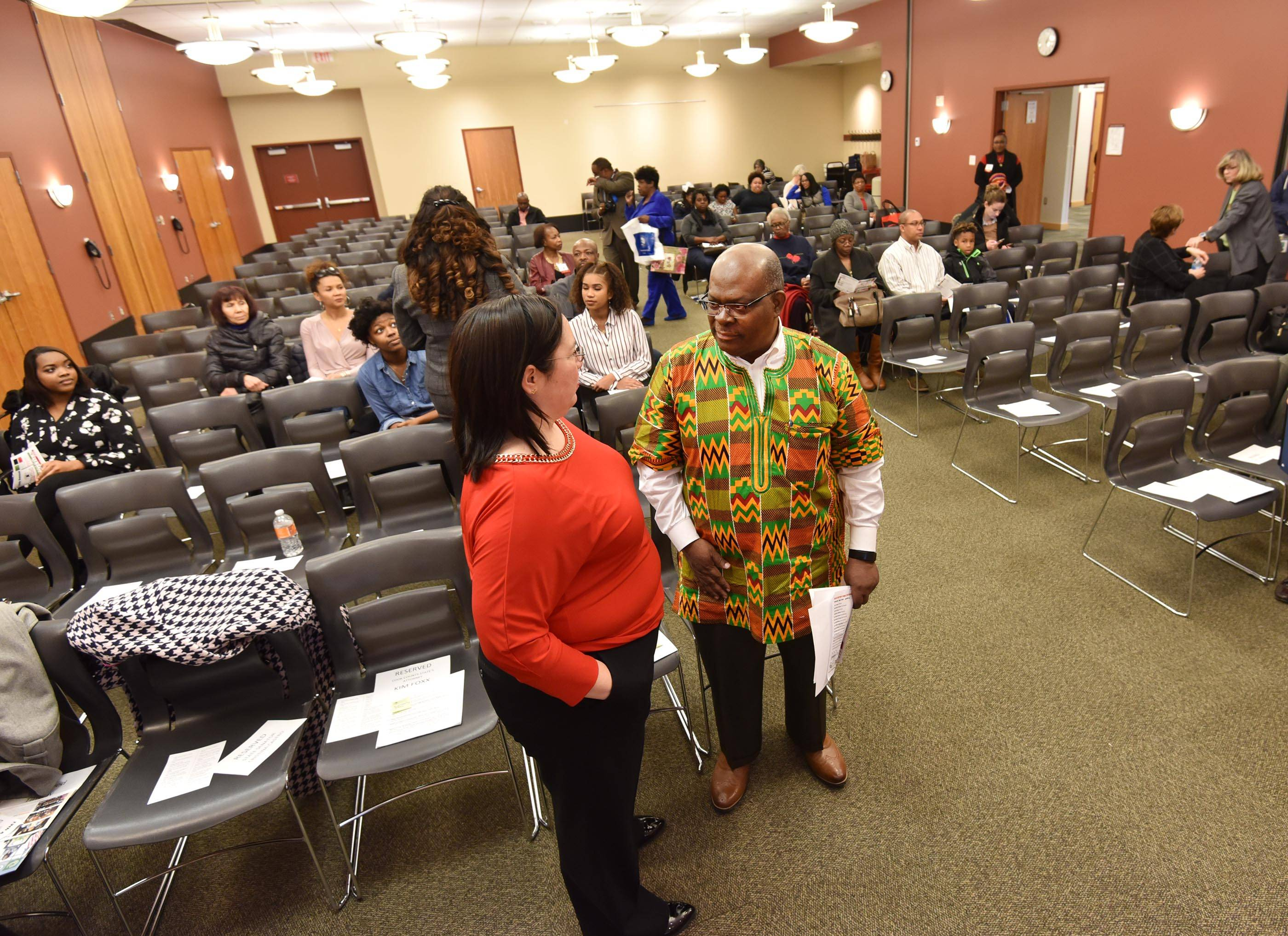 State Sen. Christina Castro, an Elgin Democrat, meets with Elgin Community College President David Sam Saturday at the Black History Family Festival at the Gail Borden Public Library.
