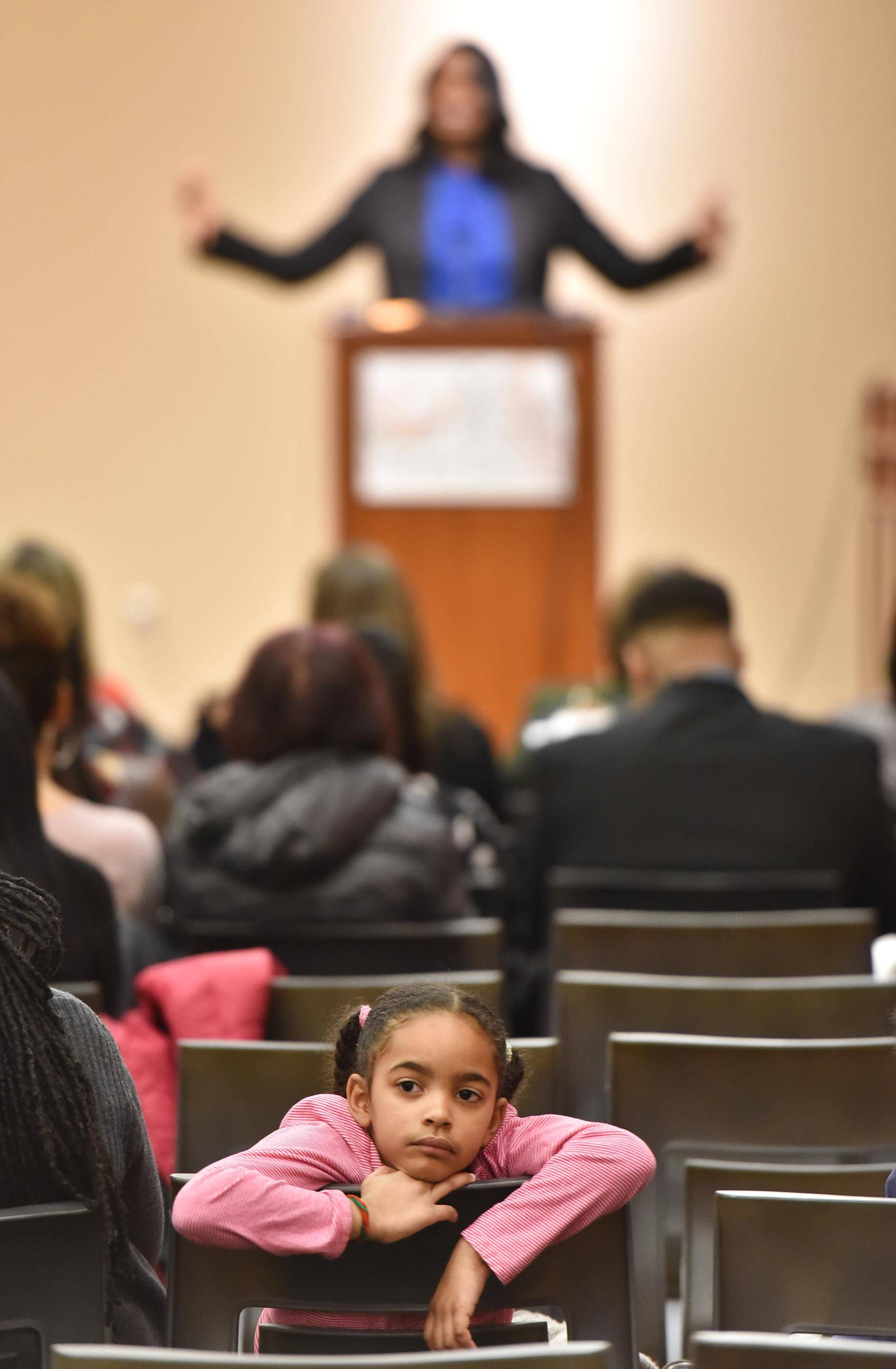 Emerson Carter, 6, looks around the room Saturday during the Black History Family Festival at the Gail Borden Public Library in Elgin as Cook County State's Attorney Kim Foxx gives a keynote speech. Foxx grew up in Chicago's Cabrini-Green housing project.