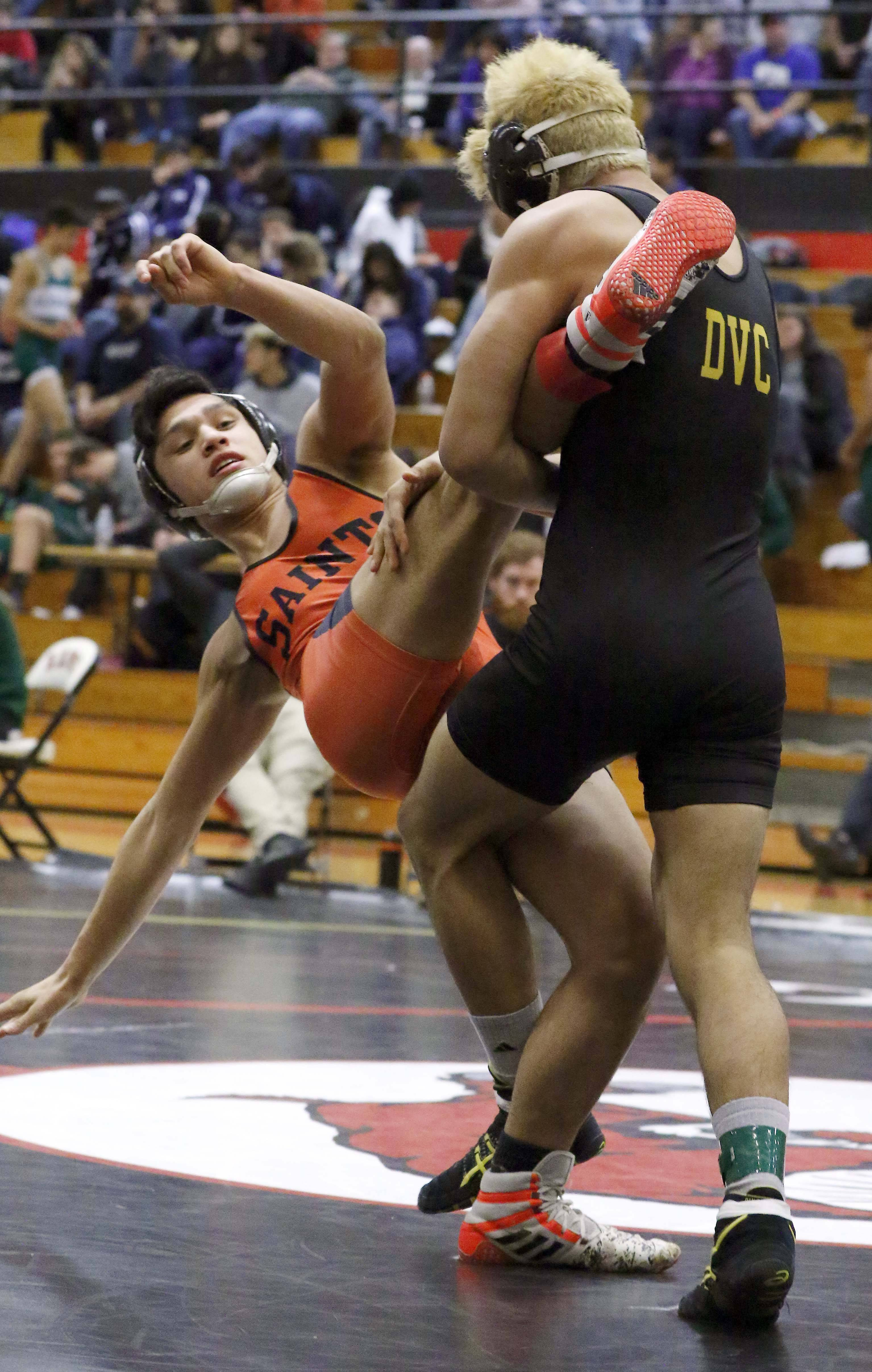 St. Charles East's Niko Derain wrestles Glenbard North's Juan Rivera at 138 pounds Saturday during the Class 3A Glenbard East wrestling regional in Lombard.