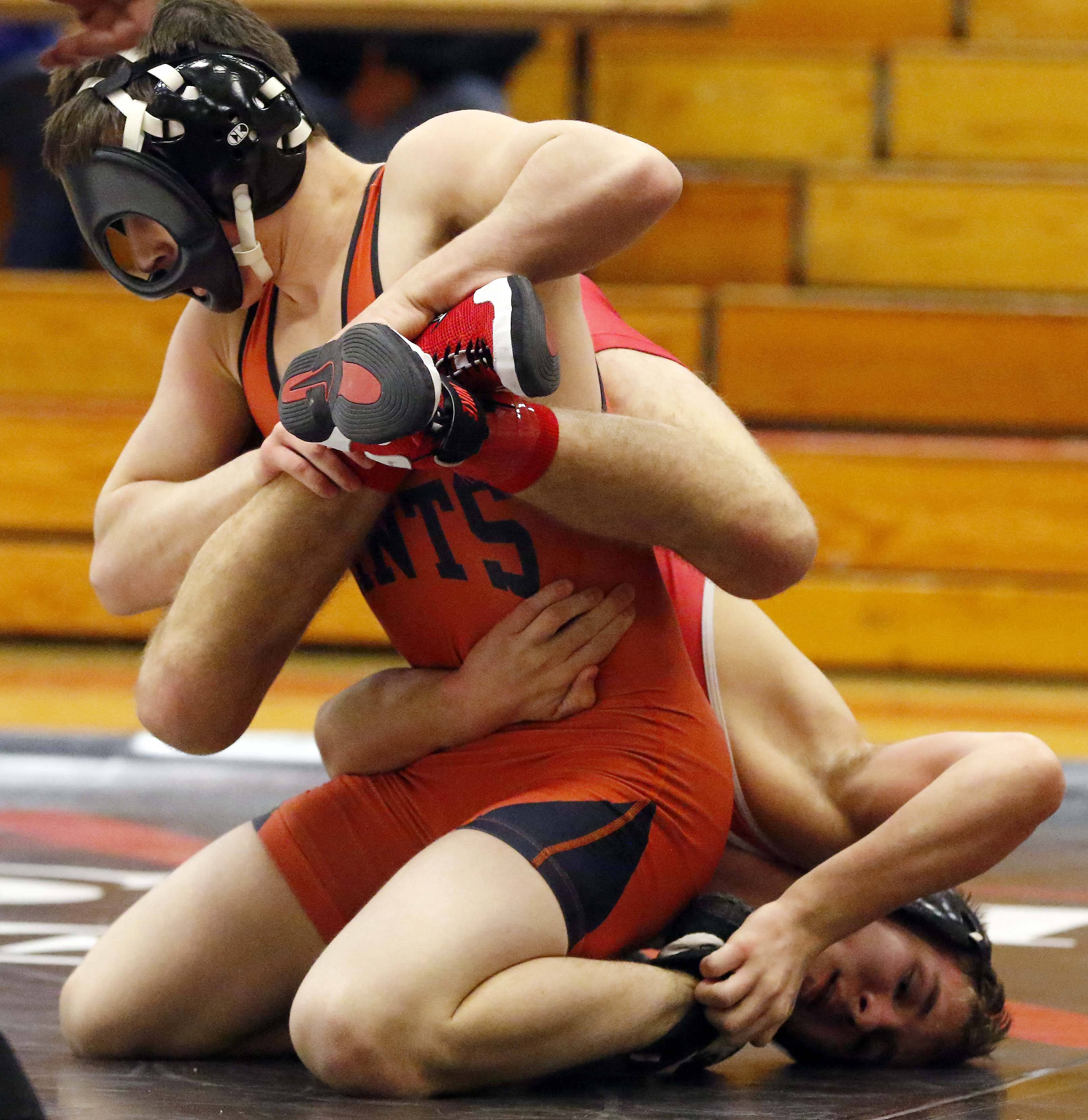 St. Charles East's Ben Anderson wrestles against Glenbard East's Reese Martin at 120 pounds Saturday during the Class 3A Glenbard East wrestling regional in Lombard.