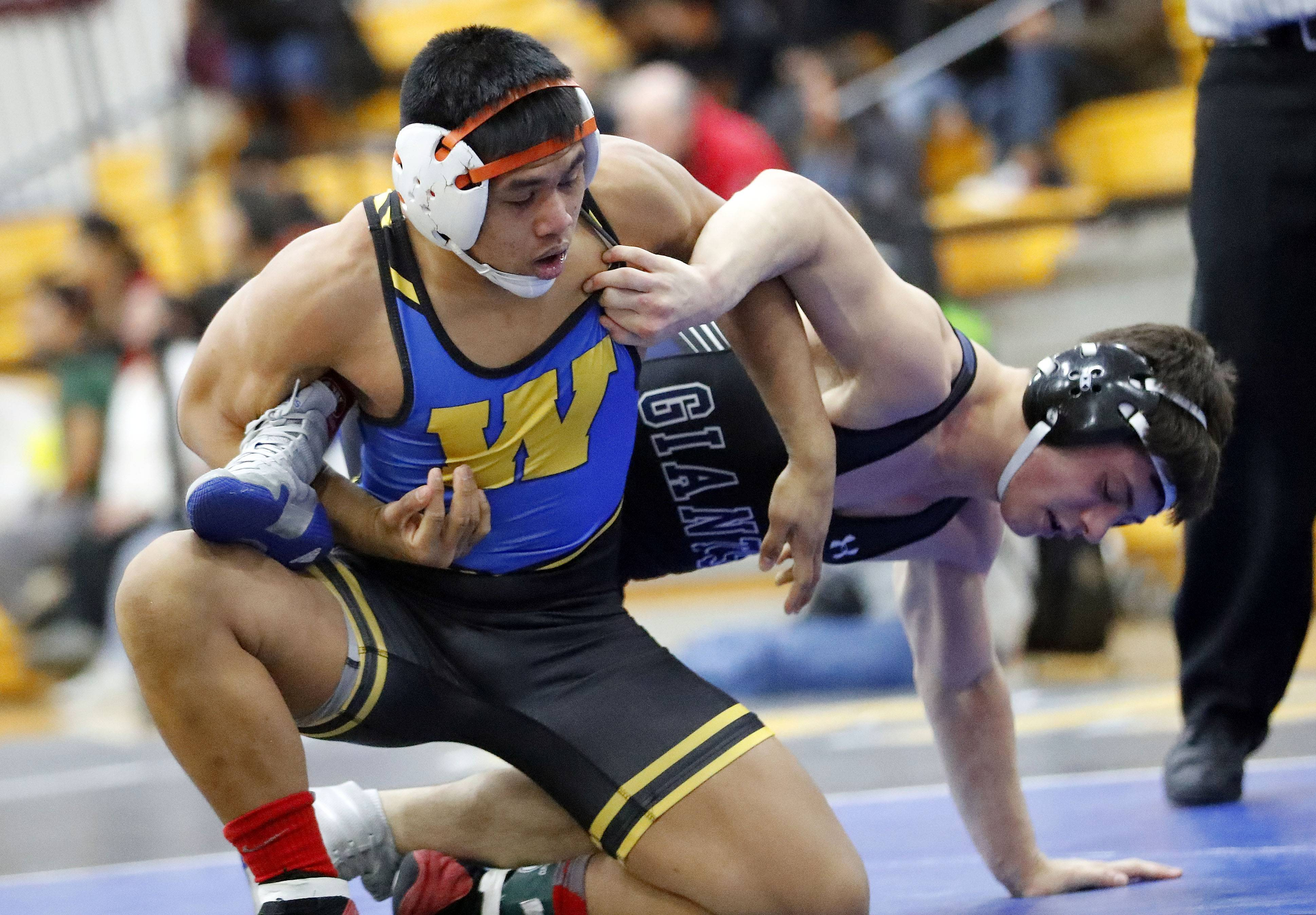 Warren's Kelvin Cupay, left, takes on Highland Park's Alex Rosenbloom in the 145-pound championship match during the Class 3A Warren regional Saturday in Gurnee.