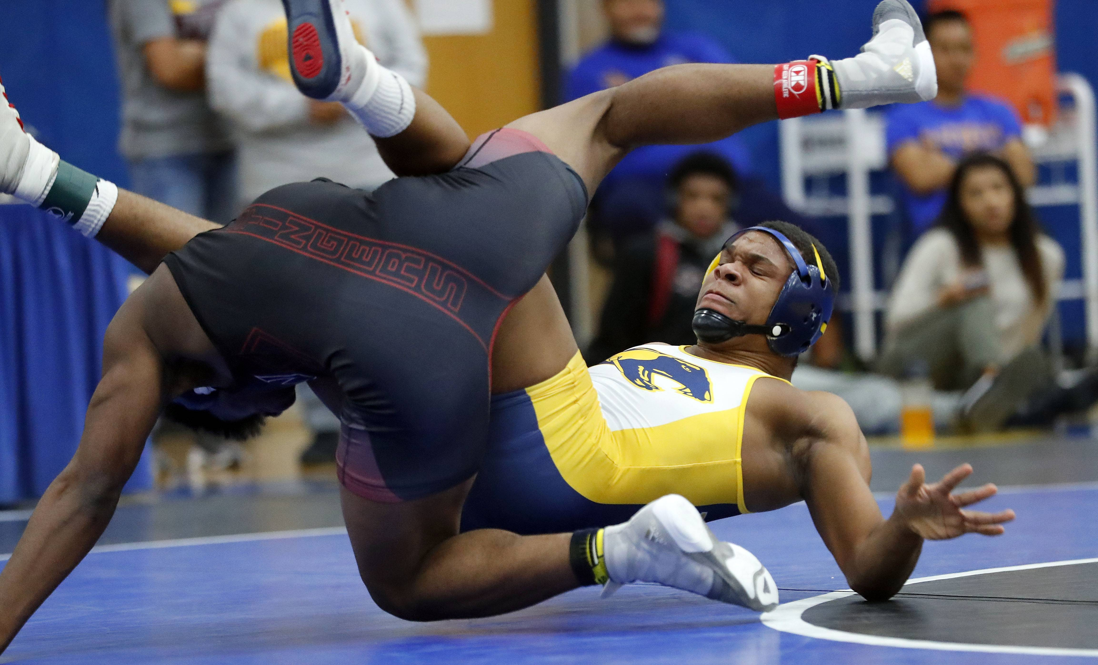 Round Lake's Shamier Austin, right, takes on Zion's DJ Chisum in the 170-pound championship match during the Class 3A Warren regional Saturday in Gurnee.