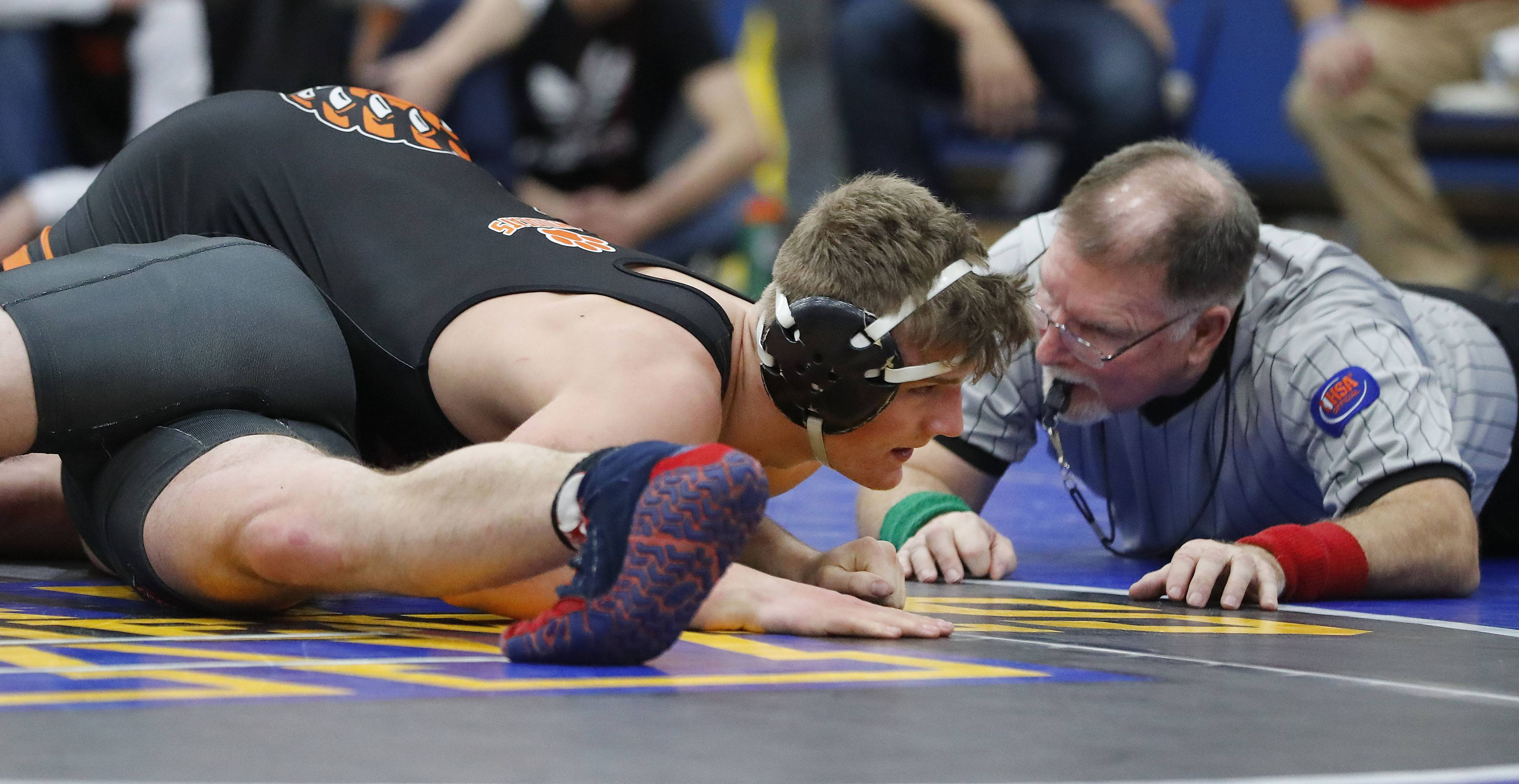 Libertyville's Ryan Damenti, right, pins Deerfield's Alex Latronica in the 170-pound third-place match during the Class 3A Warren regional Saturday in Gurnee.