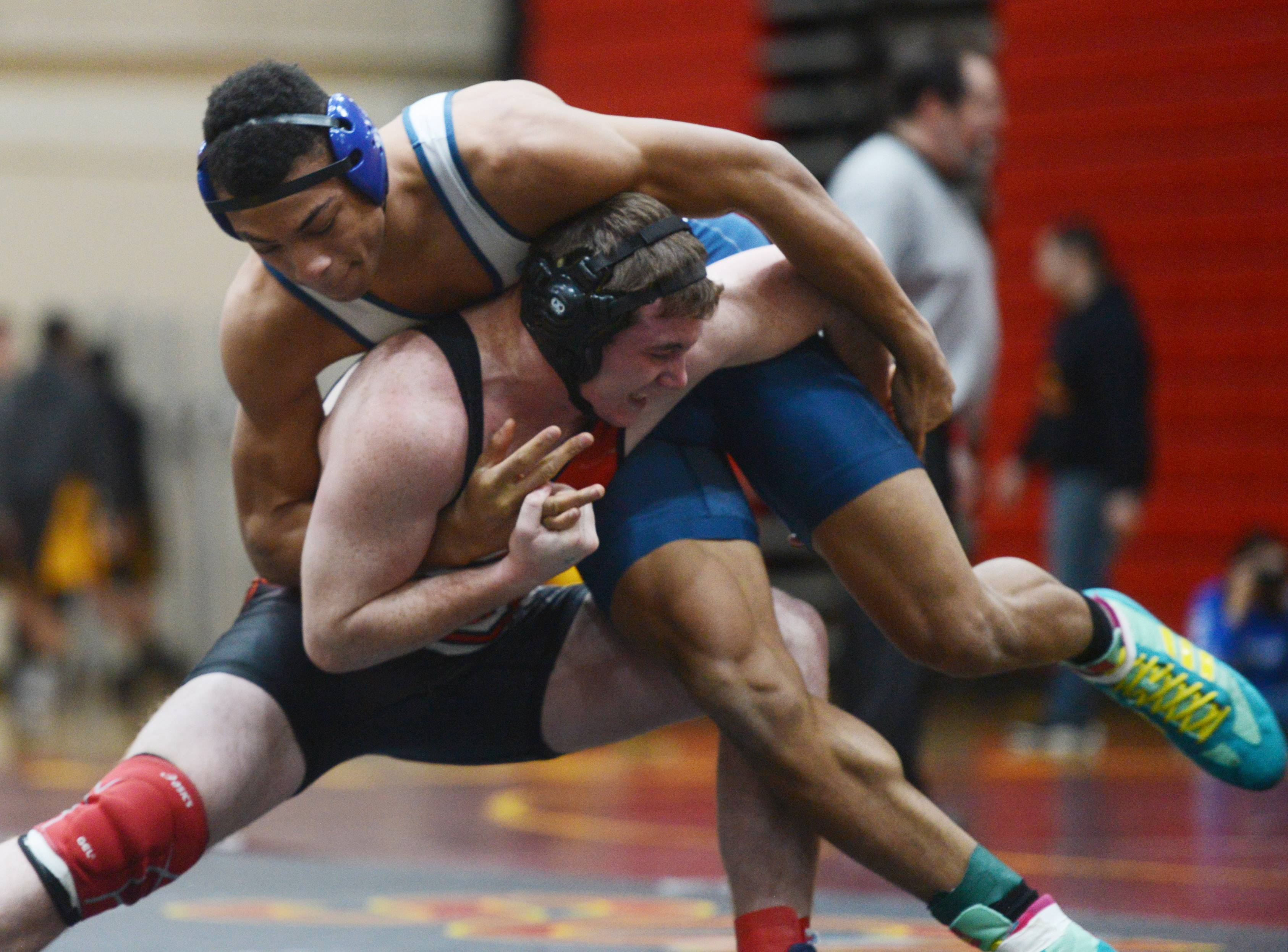 Lake Park's Demarco Lee, top, and South Elgin's Vince Clinite wrestle in a 195-pound semifinal during the Schaumburg wrestling regional Saturday.