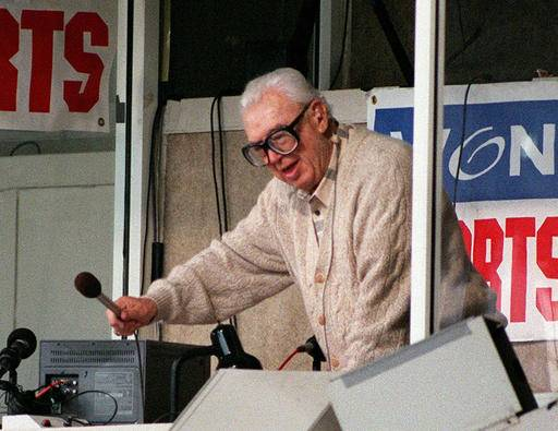 "FILE -- In this June 11, 1997 file photo, Chicago Cubs announcer Harry Caray leads fans in singing ""Take Me Out to the Ball Game"" during the seventh-inning stretch at a Cubs game at Wrigley Field in Chicago. Not since Oct. 10, 1945, has a World Series game been played at Wrigley Field in Chicago. As the World Series shifts to Chicago this weekend, all eyes are on the second-oldest ballpark in the major leagues. (AP Photo/Milwaukee Journal Sentinel, Benny Sieu, File)The Associated Press"