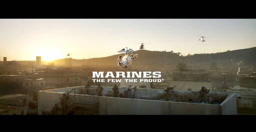 This image from a video released by the U.S. Marine Corps, that will be shown online only Sunday during the Super Bowl and targeting a young, tough, tech-savvy audience for potential recruits who are looking for a challenge. The high-powered, battle-heavy spot shows Marines deploying off ships in amphibious vehicles, dropping bombs from aircraft and hurling a shoulder-launched drone into the air. (U.S. Marine Corps via AP)