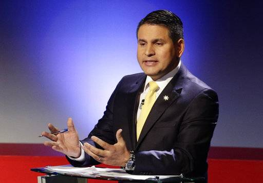 Presidential candidate Fabricio Alvarado with the National Restoration party, speaks during a live, televised debate ahead of the presidential election, in San Jose, Costa Rica, Thursday, Feb. 1, 2018. Alvarado, a 43-year-old journalist with a prominent career as a preacher and Christian singer, has vaulted to leading contender in Sunday's vote in a survey published Jan. 31 by the University of Costa Rica and the Opol consulting firm.
