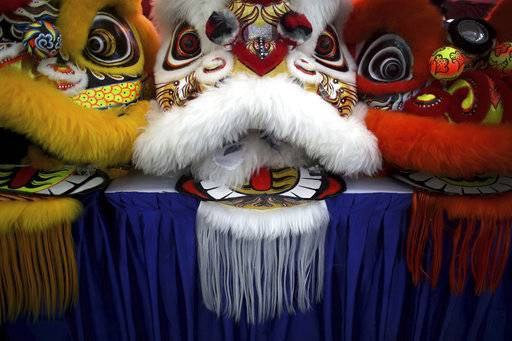 In this Friday, Feb. 2, 2018, photo, the lion heads of costumes are lined up on stage during the 11th International Lion Dance Competition in Singapore. This lion dace competition is usually held in a lead up to the Chinese Lunar New Year celebrated in Singapore. Lion dance is a traditional dance in Chinese culture and some other Asian countries in which performers from a lion dance troupe will mimic a lion's movements while dressed in a lion's costume. This is believed to bring fortune and luck. These performers from Vietnam, Singapore, Myanmar, Indonesia, Hong Kong, Taiwan and Malaysia gathered in Singapore to compete against one another and are judged on their skill, grace and musicality amongst other things.