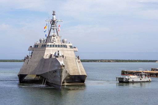 In this Jan. 3, 2018, photo released by the U.S. Navy, a Naval Station vessel, right, prepares to assist the future USS Omaha (LCS 12), a 218-foot-long littoral combat ship, pier side during a brief fuel stop in Guantanamo Bay, Cuba. The Omaha was conducting a change of homeport to San Diego, Calif. (Mass Communication Specialist 1st Class John Philip Wagner, Jr./U.S. Navy via AP)