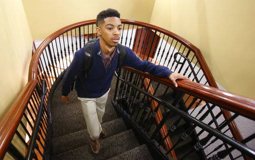 Aaron Moorer walks up stairs to the library at Hampden-Sydney College in Hampden Sydney, Va., Wednesday, Jan. 24, 2018. Moorer is from Fairfax County Va., where It's an annual rite in Fairfax County, when hundreds of second-graders trooping off to private psychologists, taking IQ tests to prove they're worthy of the county's advanced academic programs. Data shows that worthy black and Hispanic students are mostly left out.